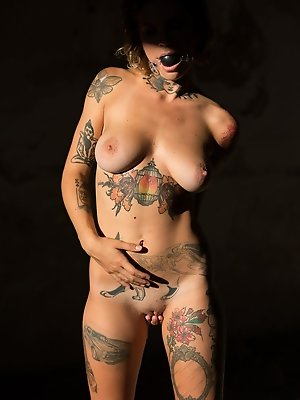 Stacy Cloud bares her lusty tattooed body as she poses in front of the camera. pics ~ SexyNakedModels.com
