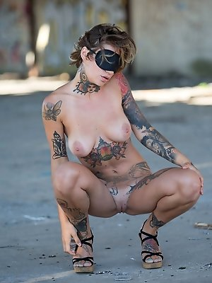 Stacy Cloud shows off her tattooed body outdoors. pics ~ SexyNakedModels.com