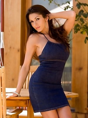 Taya Parker strips off a denim skirt to show off her stunning naked curves and huge DD boobs as she settles into a patio deck chair to enjoy the great pics ~ SexyNakedModels.com