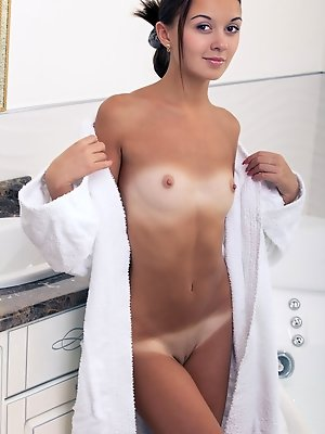 Veselin treats us to a spectacular view of her perfectly tanned body with gorgeous caramel complexion. She takes off her bath robe and take a dip in t pics ~ SexyNakedModels.com